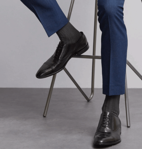 Grey socks and navy suit pants